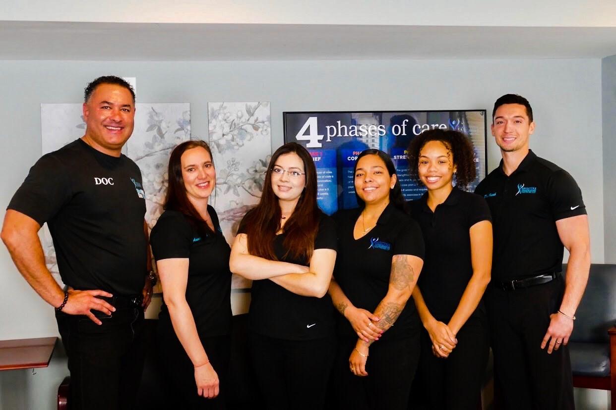 Team members of Effective Chiropractic PG County